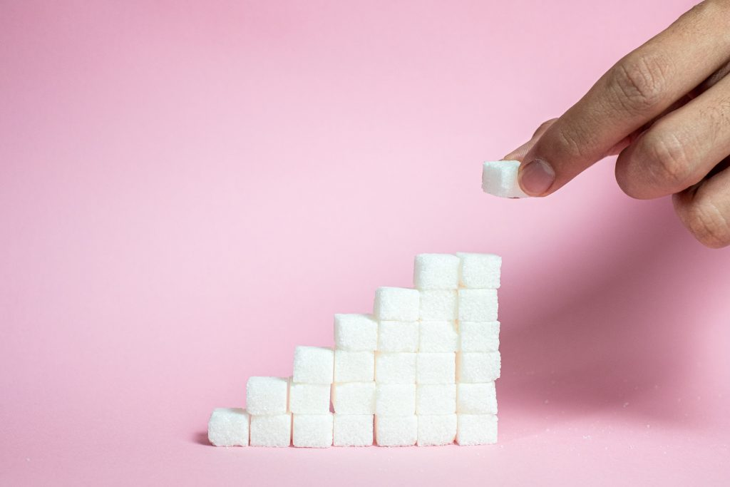 High sugar consumption as sugar triggers insulin production, disrupting the synthesis of proteins