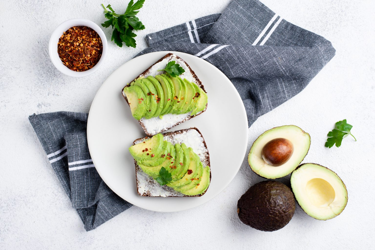 Avocado as it is rich in vitamin C and provides your hair the fatty acids needed to protect the hair